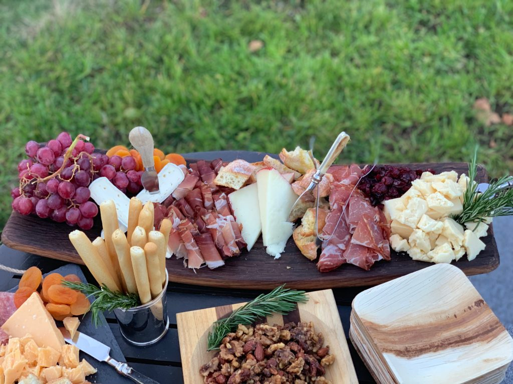 Beautiful wooden plate full of delicious looking food