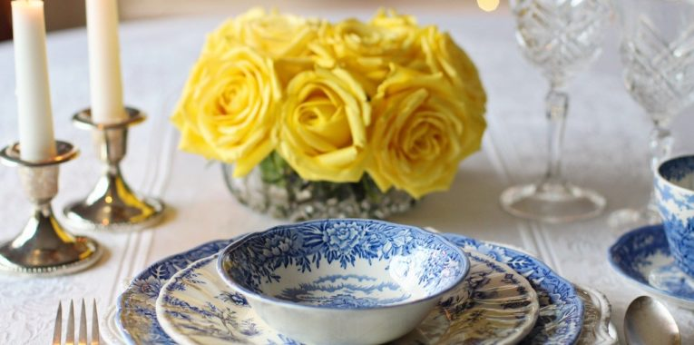 Yellow bouquet of roses in front of a place setting